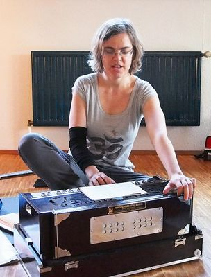 Lisa playing the harmonium